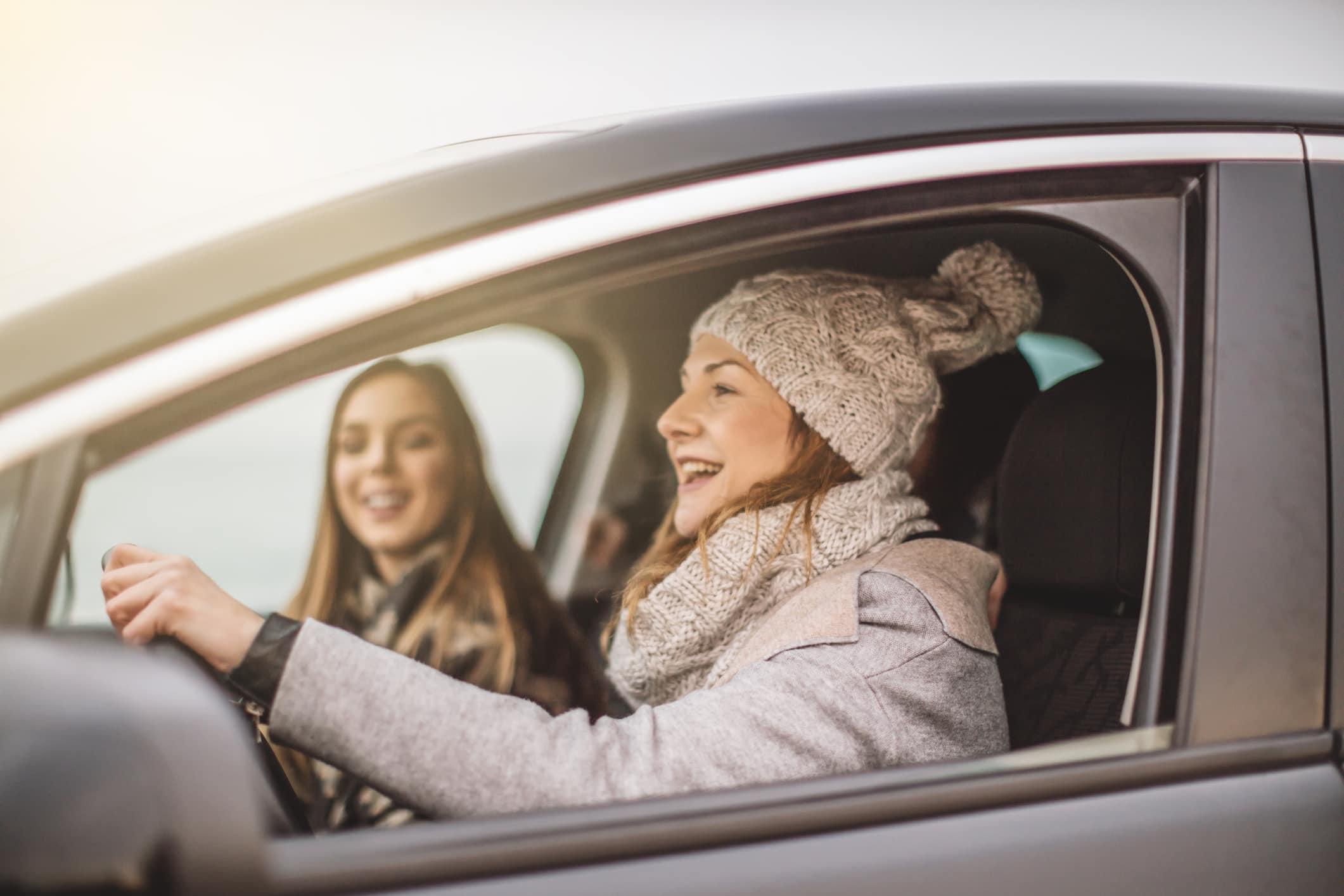 Women driving car in winter